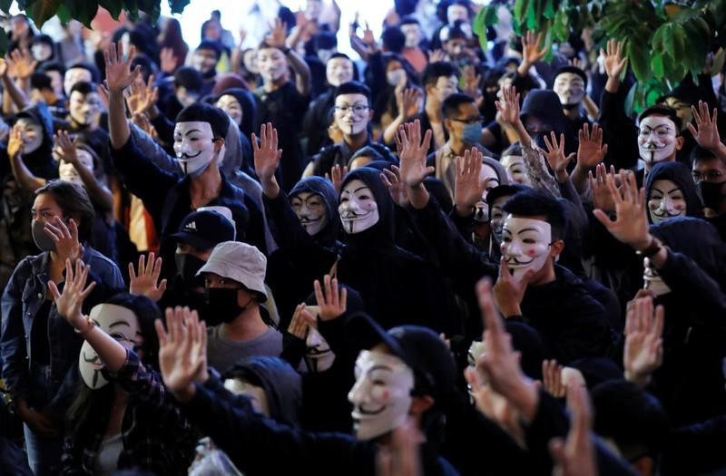 Protesters wearing Guy Fawkes masks attend an anti-government demonstration in Hong Kong
