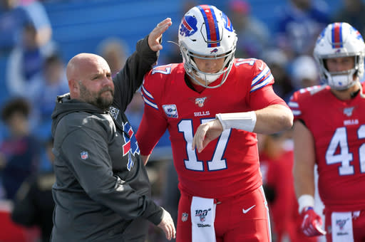 FILE - In this Oct. 20, 2019, file photo, Buffalo Bills offensive coordinator Brian Daboll, left, encourages quarterback Josh Allen as he warms up before an NFL football game Miami Dolphins, Sunday, Oct. 20, 2019, in Orchard Park, N.Y. Allen and Daboll are overseeing an offensive renaissance in Buffalo in which the suddenly pass-happy Bills are among the NFL's most explosive teams three weeks into the season. (AP Photo/Adrian Kraus, File)