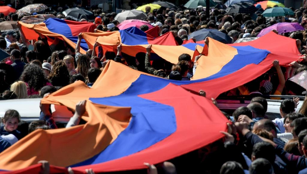 Memorials marking the anniversary of the massacre of 1.5 million Armenians by Ottoman forces in 1915 took place a day after Prime Minister Serzh Sarkisian resigned (AFP Photo/Vano Shlamov)