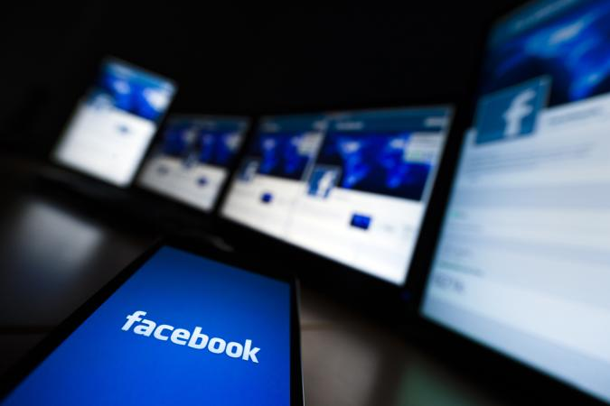 The loading screen of the Facebook application on a mobile phone is seen in this photo illustration taken in Lavigny May 16, 2012. Facebook Inc increased the size of its initial public offering by almost 25 percent, and could raise as much as $16 billion as strong investor demand for a share of the No.1 social network trumps debate about its long-term potential to make money. Facebook, founded eight years ago by Mark Zuckerberg in a Harvard dorm room, said on Wednesday it will add about 84 million shares to its IPO, floating about 421 million shares in an offering expected to be priced on Thursday. REUTERS/Valentin Flauraud (SWITZERLAND - Tags: BUSINESS SCIENCE TECHNOLOGY SOCIETY)