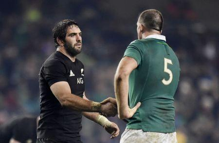 Ireland's Devin Toner shakes hands with New Zealand's Sam Whitelock after the match