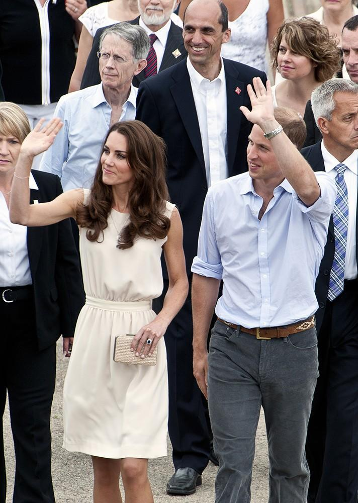 """Kate wore this simple white shift during their Canada visit, carrying her favorite L.K. Bennett """"Natalie"""" clutch."""