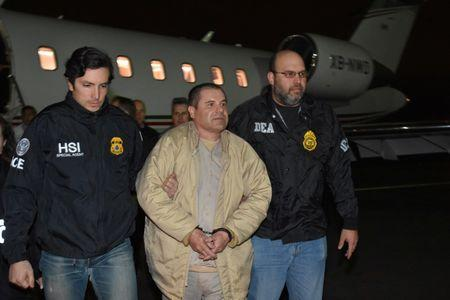 """Mexico's top drug lord Joaquin """"El Chapo"""" Guzman is escorted as he arrives at Long Island MacArthur airport in New York, U.S., January 19, 2017, after his extradition from Mexico. U.S. officials/Handout via REUTERS"""