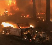 """Thousands evacuated as """"erratic"""" wildfires rage in California"""