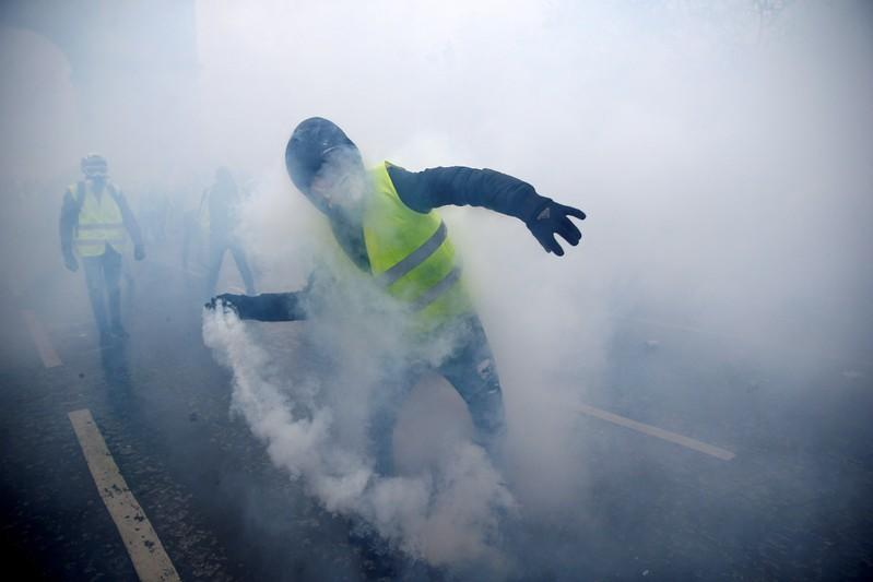 Paris police fire tear gas on 'yellow vest' protests anniversary