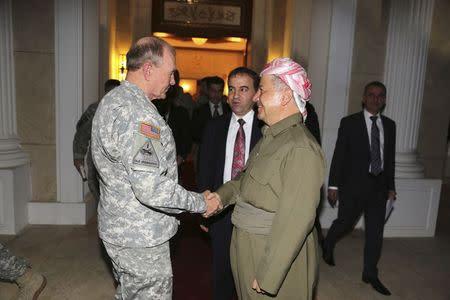 Iraqi Kurdish regional President Masoud Barzani (R) meets with Chairman of the Joint Chiefs, U.S. Army General Martin Dempsey in Arbil, north of Baghdad, November 15, 2014. REUTERS/Azad Lashkari
