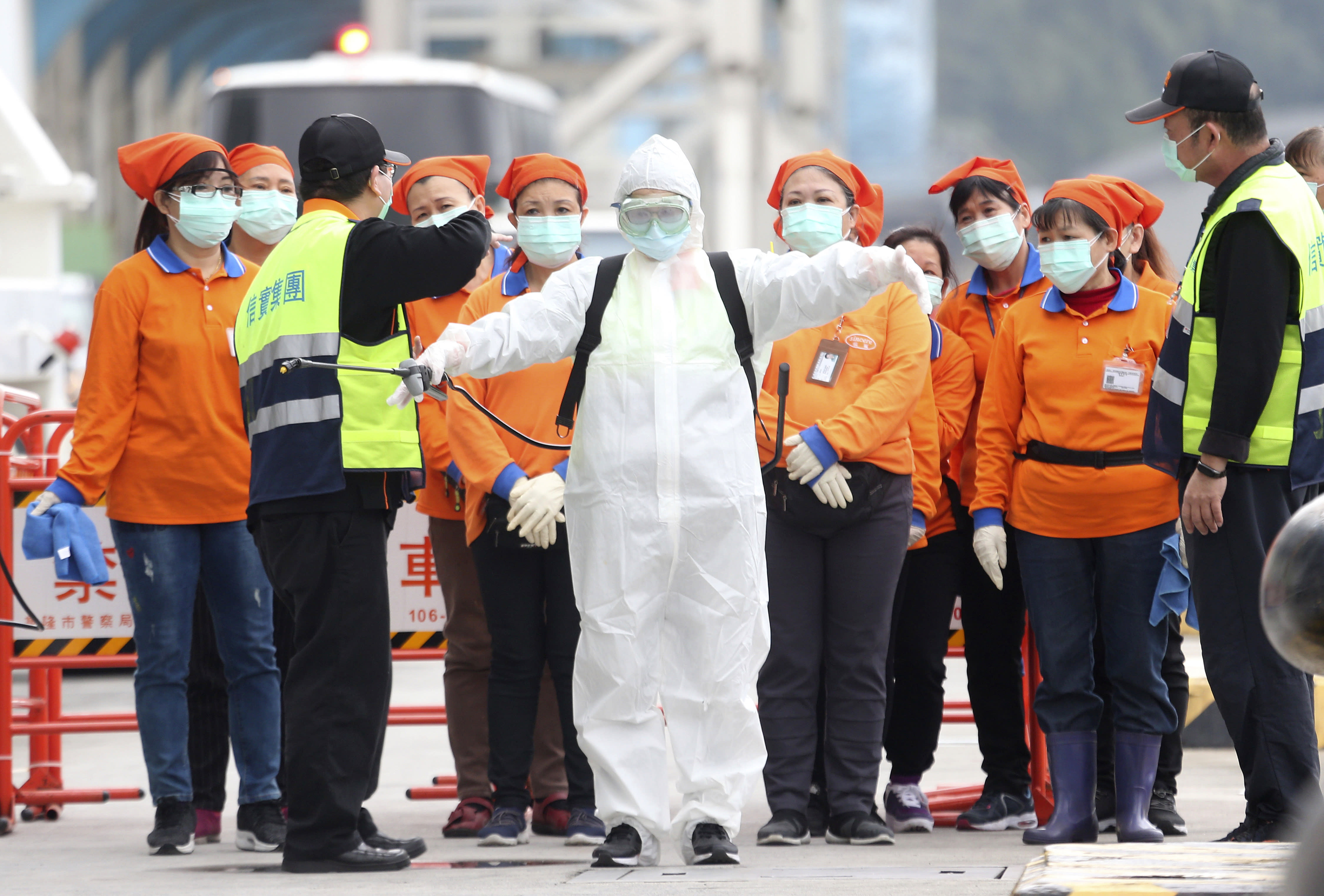 FILE - In this Saturday, Feb, 8, 2020, file photo, an epidemic prevention worker in a protective suit stands by to get on board the cruise ship SuperStar Aquarius which was denied right to dock by Japan over fears of spread of virus and returned to dock at Keelung port in New Taipei City, Taiwan. Taiwan's exclusion from the World Health Organization is pitting health concerns against geopolitics during the current crisis over a new virus. Taiwan has called repeatedly for it to be allowed to participate in WHO, from which it has been barred by China. So strong is China's diplomatic pressure that Taiwan can no longer take part in the organization's annual World Health Assembly, even as an observer. (AP Photo/Chiang Ying-ying, File)