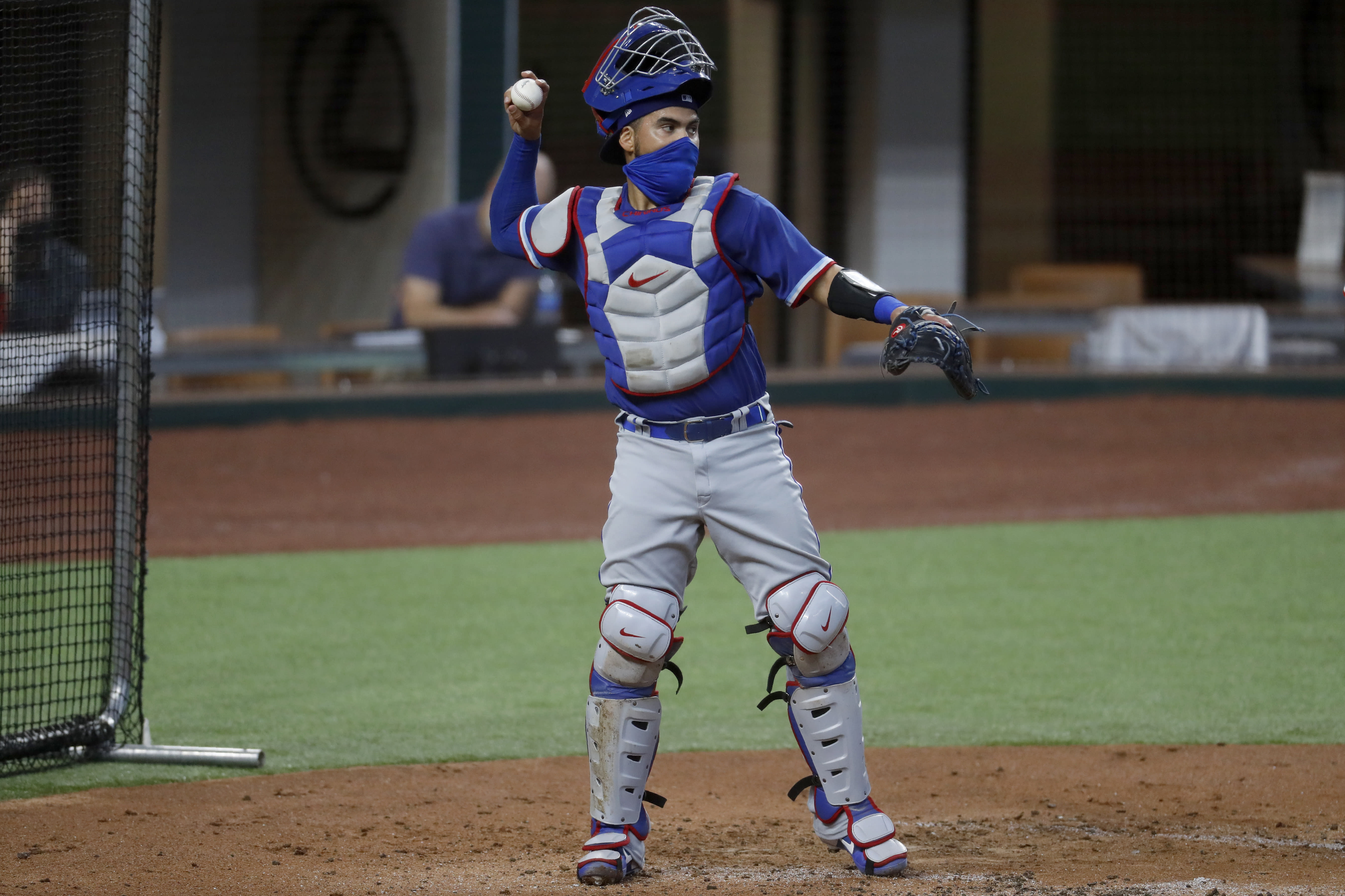 Texas Rangers catcher Robinson Chirinos throws to the mound during an intrasquad game during baseball practice in Arlington, Texas, Thursday, July 9, 2020. (AP Photo/Tony Gutierrez)