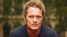 'Neighbours' star Craig McLachlan says sexual assault claims ruined his life in tearful video