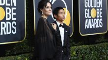 Angelina Jolie Brings Son Pax to the 2018 Golden Globes, Wears Feather-Adorned Dress