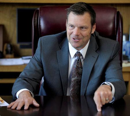 FILE PHOTO: Kansas Secretary of State Kris Kobach talks about the Kansas voter ID law that he pushed to combat what he believes to be rampant voter fraud in the United States in his office in Topeka, Kansas, U.S., on May 12, 2016. REUTERS/Dave Kaup/File Photo