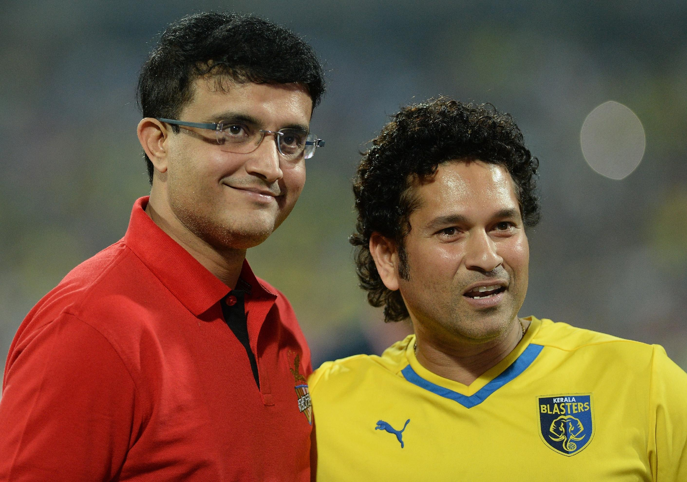 Sachin Tendulkar (right) and Saurav Ganguly await the before the start of the Indian Super League final between Kerala Blasters and Atletico de Kolkata at The D.Y. Patil stadium in Navi Mumbai on December 20, 2014