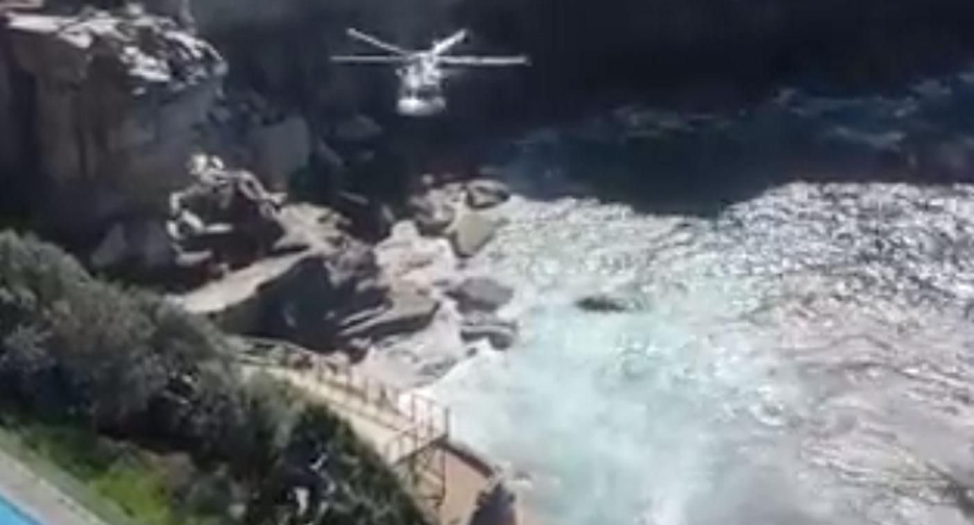 Woman dies after falling off cliff in wealthy Sydney suburb