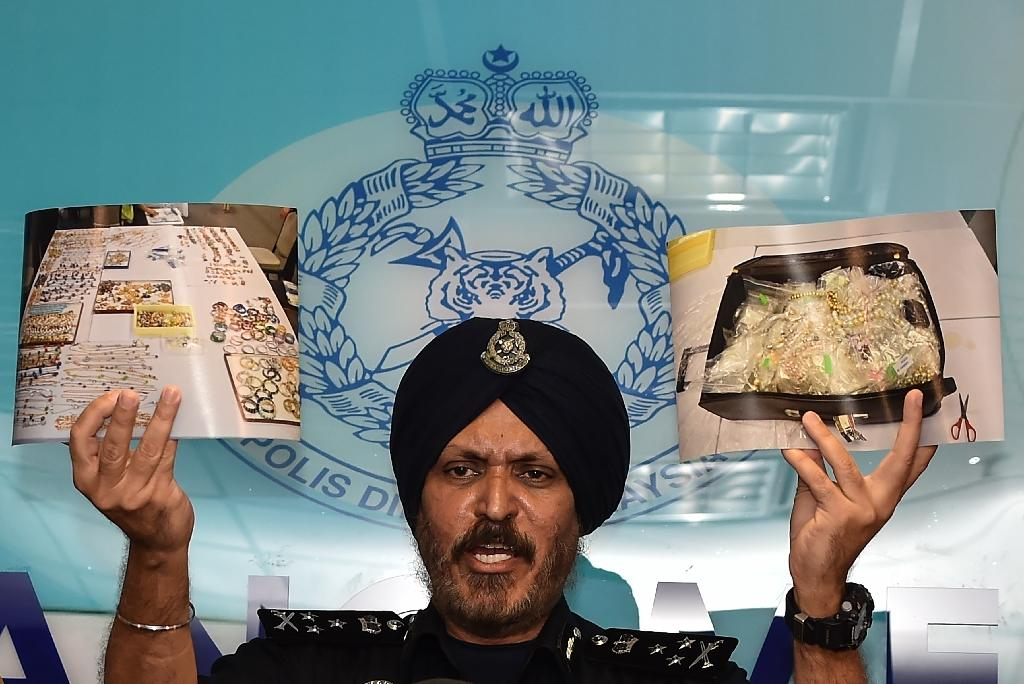 The raids on several properties linked to ex-PM Najib Razak netted 12,000 pieces of jewellery, bags containing almost $30 million in cash and hundreds of watches and pairs of sunglasses (AFP Photo/Mohd RASFAN)