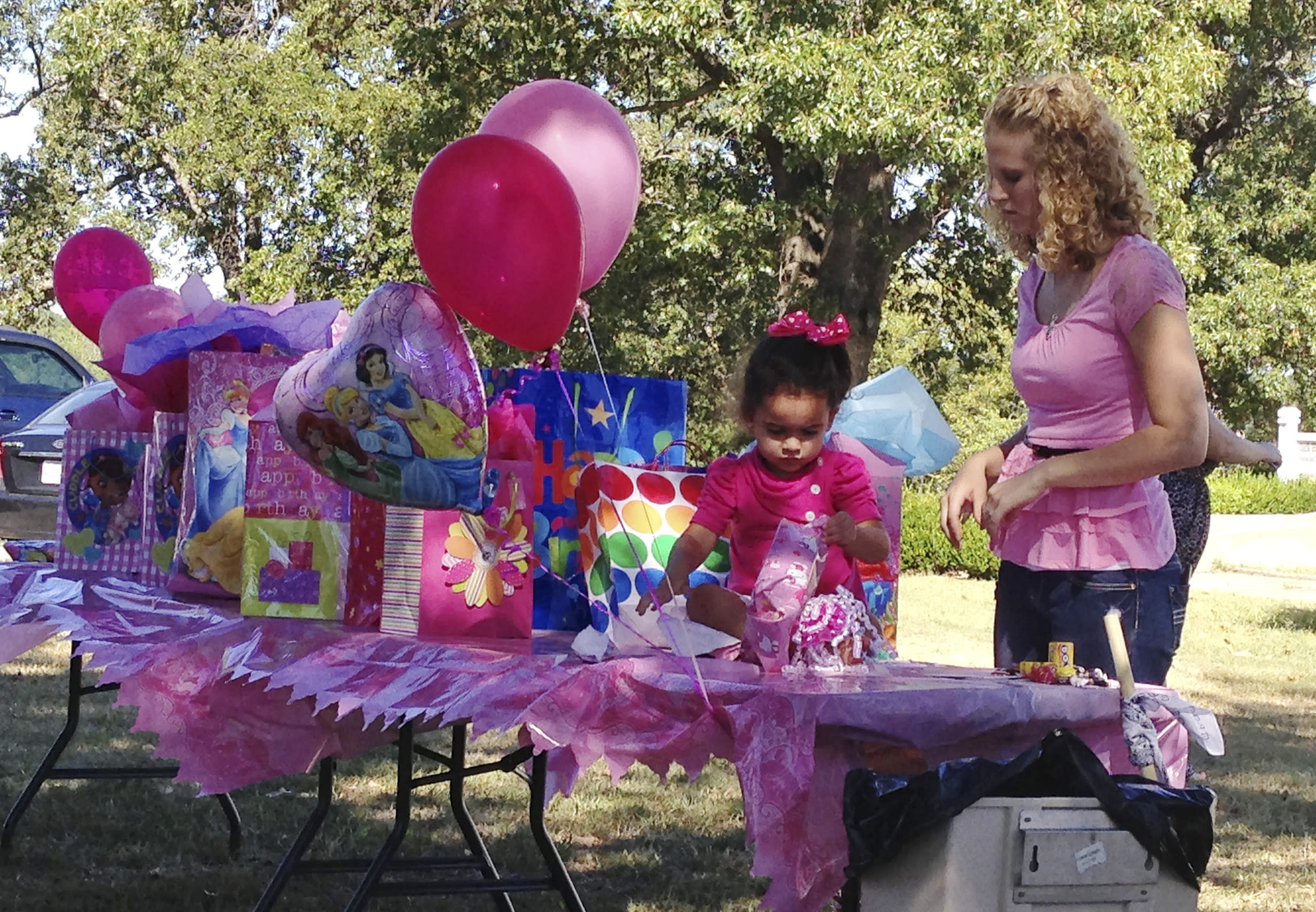 This photo provided by Amanda Clinton of the Cherokee Nation shows four-year-old Veronica, left, with Robin Brown, right, at a birthday party for her in Tahlequah, Okla. The Oklahoma Supreme Court on Monday, Sept. 23, 2013 said it won't intervene in an adoption dispute involving the Cherokee girl and dissolved a court order that was keeping her with her father. It wasn't immediately clear whether Veronica would remain in the Cherokee Nation, where she's been living with her biological father, Dusten Brown, and his family while Brown appealed court orders finalizing her adoption to Matt and Melanie Capobianco of South Carolina. (AP Photo/Cherokee Nation, Amanda Clinton)