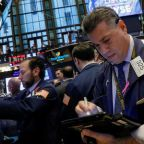 U.S. dollar, Wall Street fall with tax overhaul in focus
