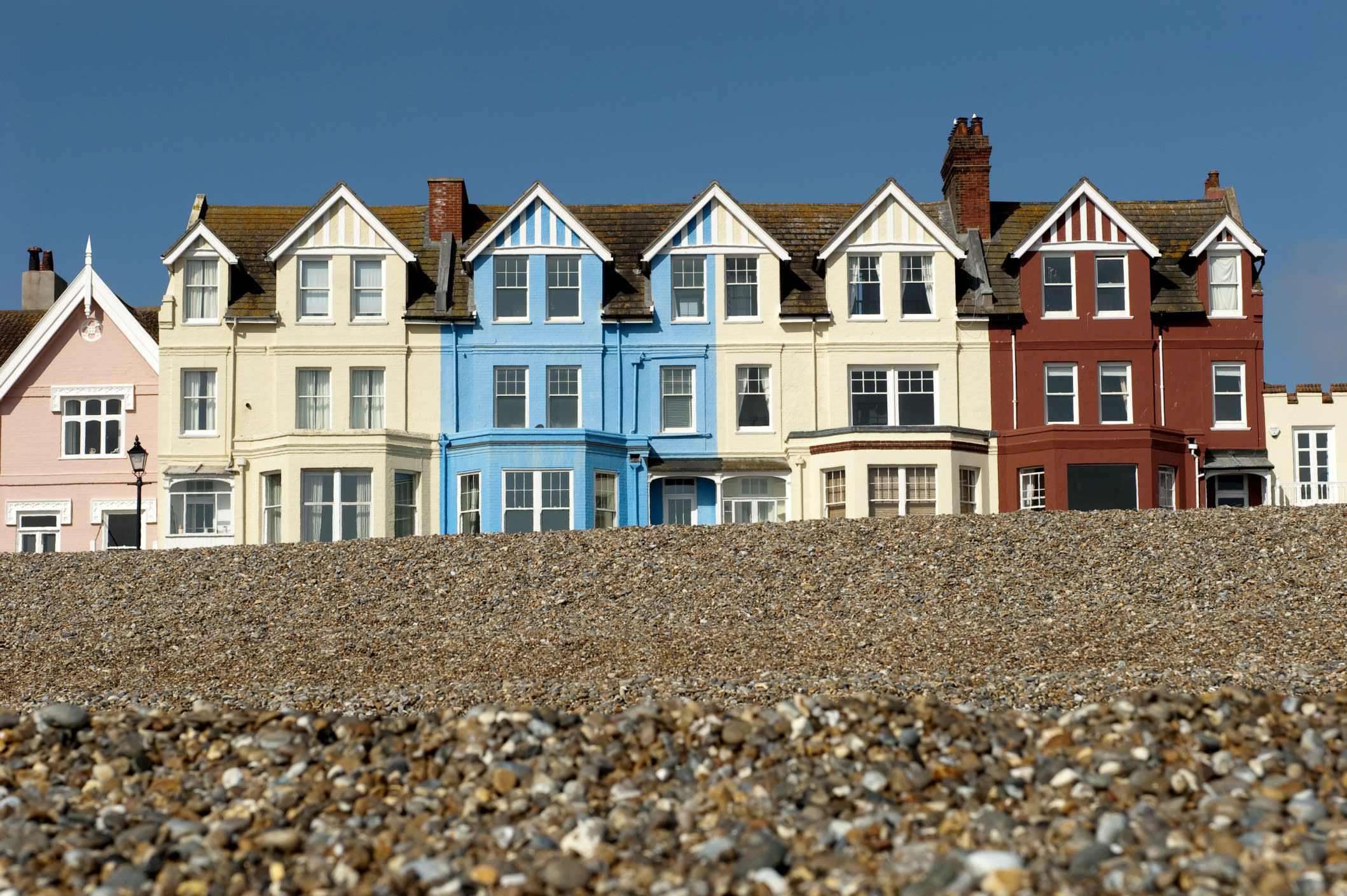"""This quiet town on the Suffolk coast is the birthplace of world-famous musician Benjamin Britten and retains its musical importance to this day as it holds the <a href=""""https://tickets.aldeburgh.co.uk/Online/festival"""" target=""""_blank"""">Aldeburgh Music Festival</a> over three weeks every June. The area is also lucky enough to boast, on average, two hours' more sunshine each week than anywhere else in England, making it the perfect peaceful holiday destination while located just a few hours' drive from London.The four-star <a href=""""http://www.brudenellhotel.co.uk/"""" target=""""_blank"""">Brudenell Hotel</a> has a seafront terrace just a pebble's throw from Aldeburgh's beach, with seaview rooms from £175 per night for two sharing."""