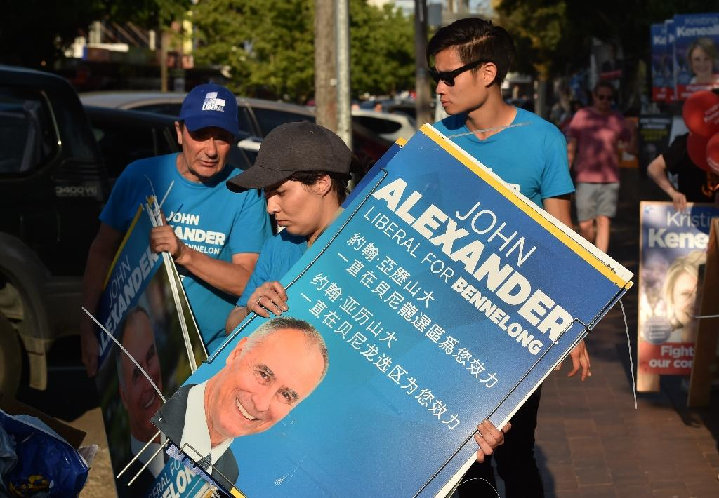 Australia government scrapes through by-election test