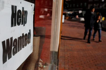 "FILE PHOTO: A ""Help Wanted"" sign sits in the window of a shop in Harvard Square in Cambridge"