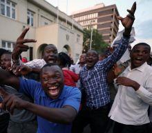 Zimbabweans Celebrate In The Streets After Mugabe Resignation