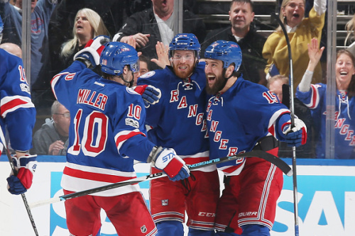 NEW YORK, NY - MAY 04: Oscar Lindberg #24, Tanner Glass #15 and J.T. Miller #10 of the New York Rangers celebrate after scoring a goal in the second period against the Ottawa Senators in Game Four of the Eastern Conference Second Round during the 2017 NHL Stanley Cup Playoffs at Madison Square Garden on May 4, 2017 in New York City. (Photo by Jared Silber/NHLI via Getty Images)