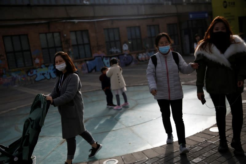 China reports 49 new coronavirus cases, conducting mass testing in Xinjiang