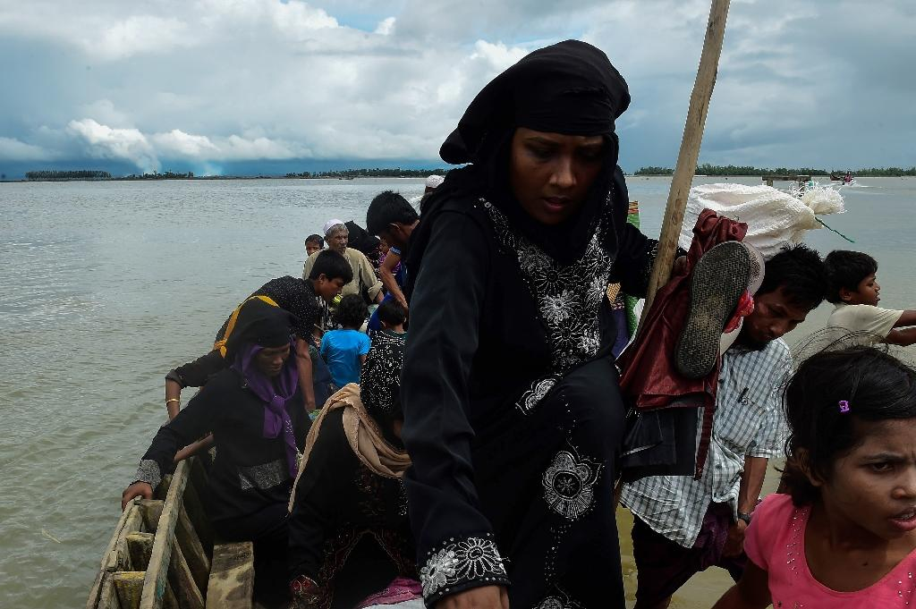 Many Rohingya have trekked across hills and through jungles for days to reach the border with Myanmar and have told of the demands made by gangs and individuals to get a place on a boat crossing the Naf river that divides the two countries (AFP Photo/MUNIR UZ ZAMAN)