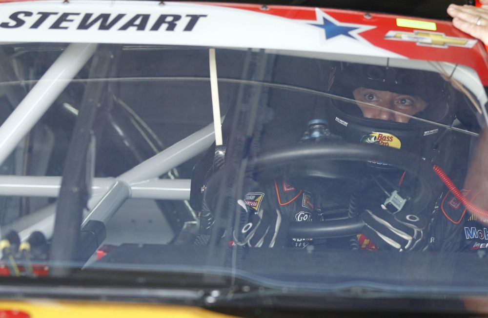 Tony Stewart waits in his car before practice for Sunday's NASCAR Sprint Cup series Coca-Cola 600 auto race at Charlotte Motor Speedway in Concord, N.C., Thursday, May 22, 2014