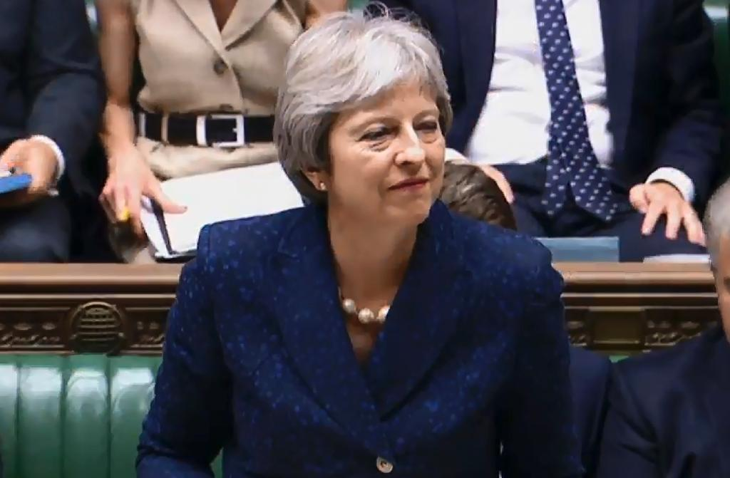 Britain's Prime Minister Theresa May has been dealt a blow with the resignation of two ministers (AFP Photo/HO)
