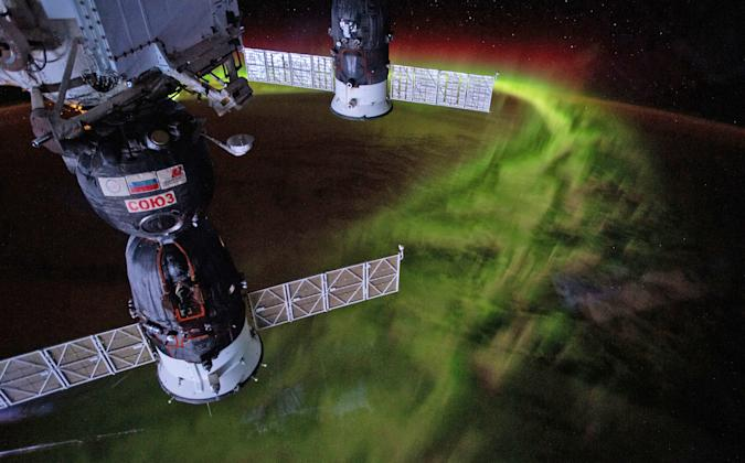 The ISS over earth showing the aurora borealis.