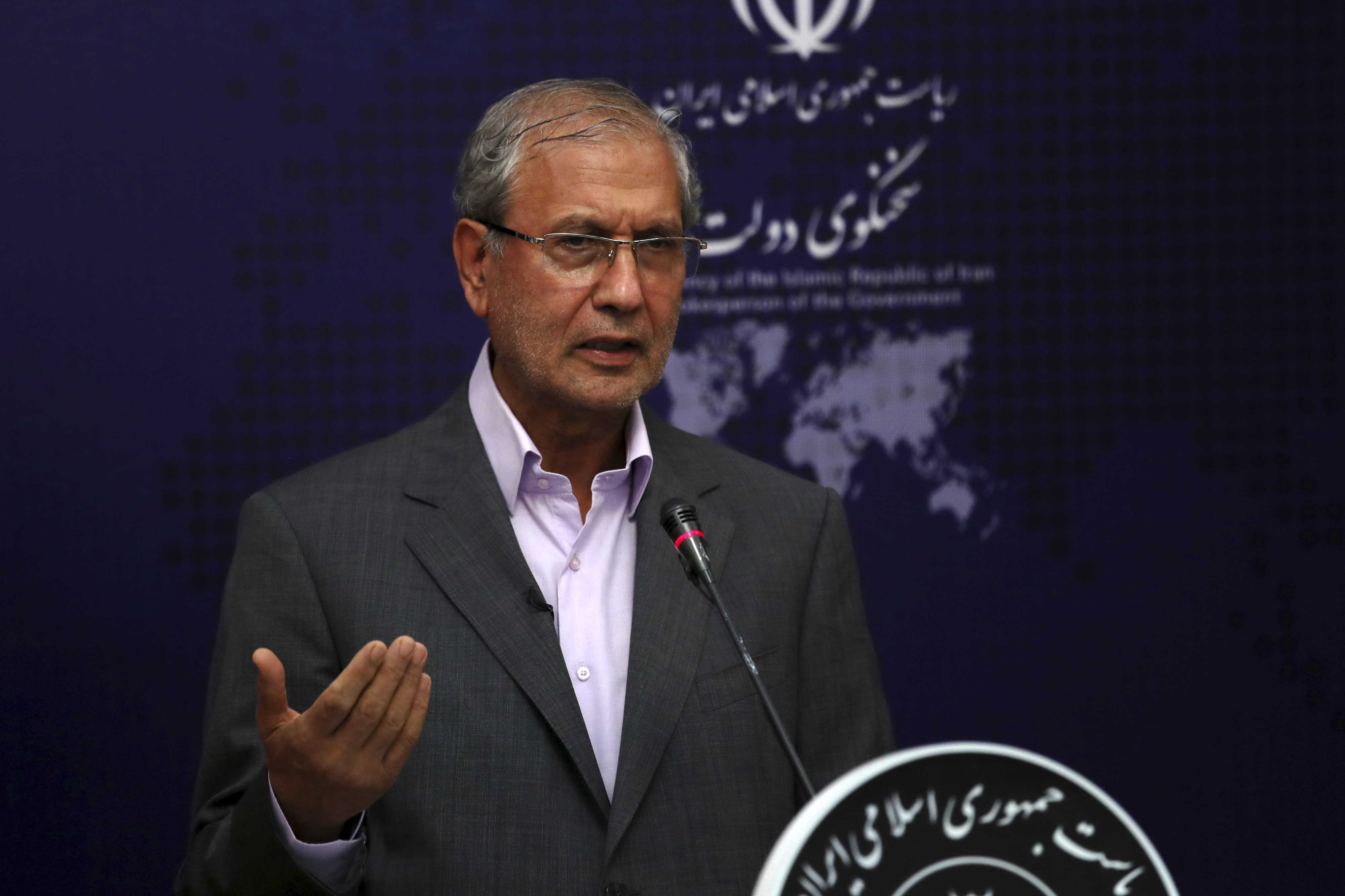 Iran's government spokesman Ali Rabiei speaks in his regular news briefing, Monday, July 22, 2019. Ali Rabiei said that there are diplomatic solutions to the current crisis, but he also defended Iran's actions, three days after Iran's Revolutionary Guard seized a British-flagged oil tanker called Stena Impero, and two weeks after the seizure of an Iranian oil tanker by Gibraltar, a British overseas territory off the southern coast of Spain. (AP Photo/Vahid Salemi)