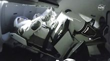 SpaceX capsule with astronauts onboard successfully docks with space station