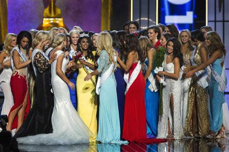 Miss America contestant, Miss New York Nina Davuluri celebrates after being chosen winner of the 2014 Miss America Pageant in Atlantic City, New Jersey