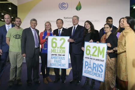 UN Secretary-General Ban Ki-moon and Al Gore, former US Vice President and Climate Reality Project Chairman, pose with representatives of NGO's, during the World Climate Change Conference 2015 (COP21) at Le Bourget