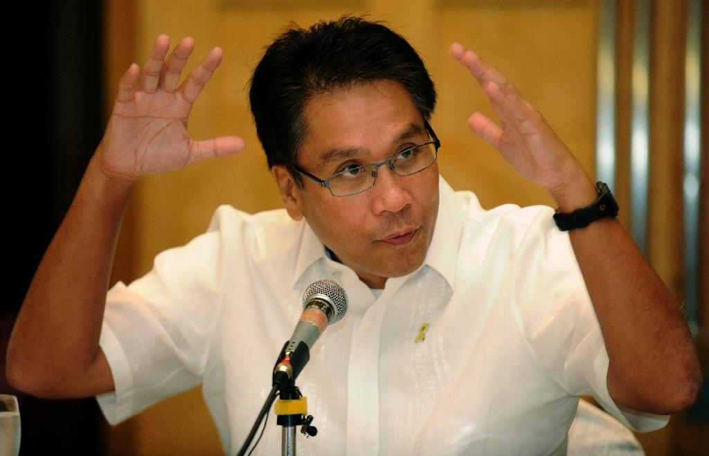 Manuel Roxas gestures as he briefs the foreign press in Manila on October 7, 2011