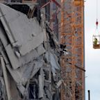 Demolition of cranes atop collapsed Hard Rock Hotel delayed after more damage found