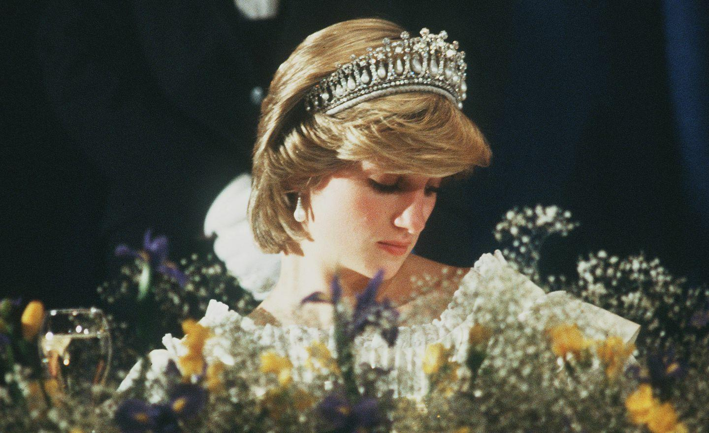 <p>Diana looks deep in thought on her wedding day.</p>
