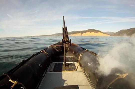 Watch Lockheed Martin's laser weapon take down boats from a mile away