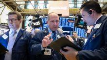 Wall St fecha em baixa com balanços e comentários de Draghi