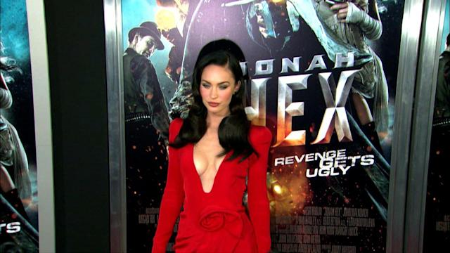 Megan Fox Covers Her Baby Bump on Family Outing