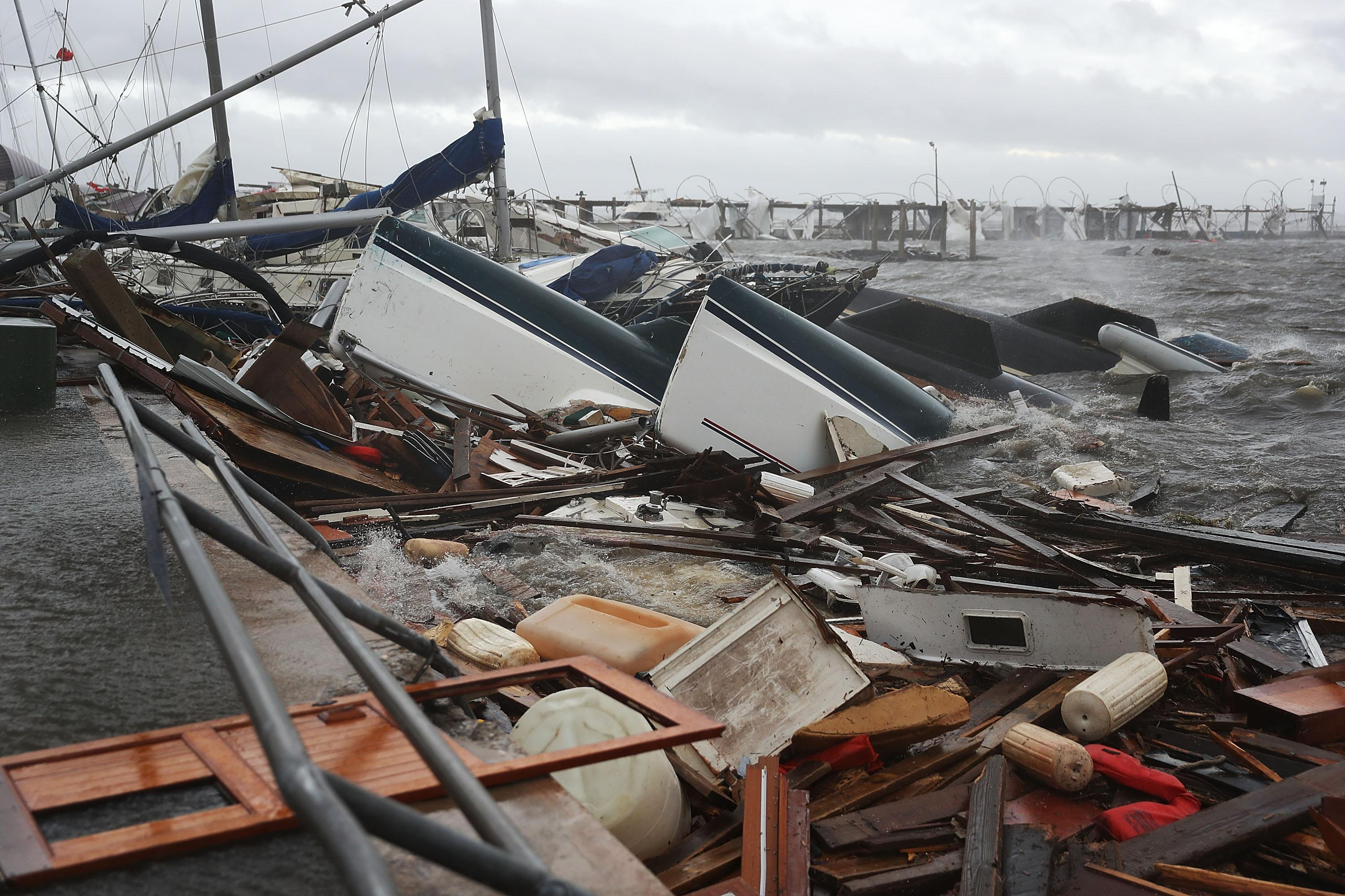 <p>Boats that were docked are seen in a pile of rubble after hurricane Michael passed through the downtown area on Oct. 10, 2018 in Panama City, Fla. (Photo: Joe Raedle/Getty Images) </p>