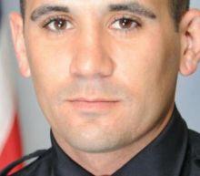 Police officer shot dead by murder suspect during standoff