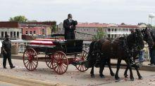 Civil rights hero John Lewis crosses Selma bridge for final time