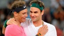 Roger Federer congratulates Rafael Nadal on tying male Grand Slam record