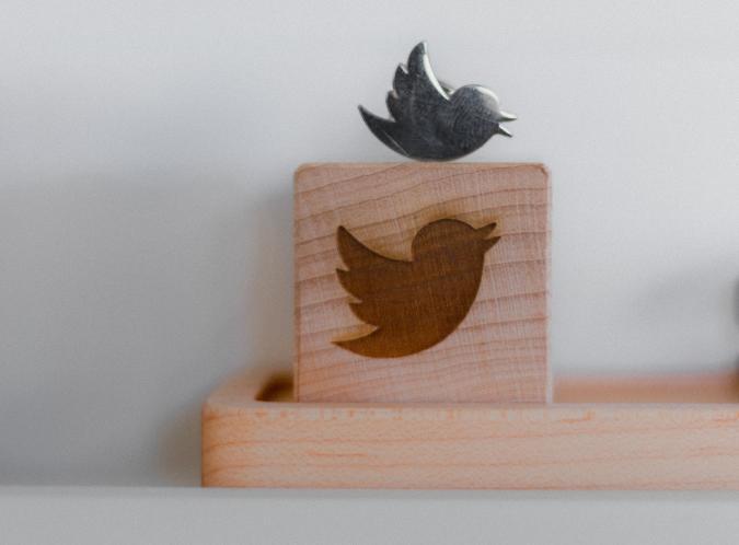 A woodblock featuring the Twitter bird logo