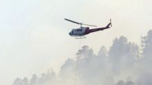 Colorado wildfire spreads as winds strengthen