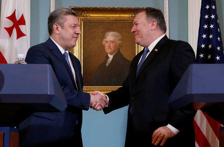 U.S. Secretary of State Mike Pompeo shakes hands with Georgia's Prime Minister Giorgi Kvirikashvili after delivering remarks at their Georgia Strategic Partnership meeting at the State Department in Washington, U.S., May 21, 2018. REUTERS/Leah Millis