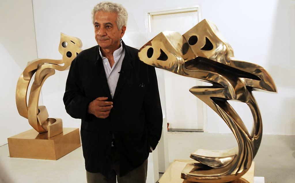 Iranian artist Parviz Tanavoli had dedicated his new work to Cecil the lion (AFP Photo/Haider Shah)