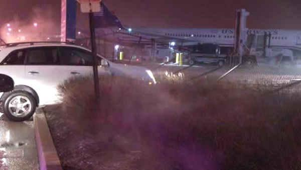 SUV crashes, nearly hits plane at Phila. Int'l Airport