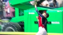 Junior Leaguer goes over the wall to make fantastic homer-saving grab
